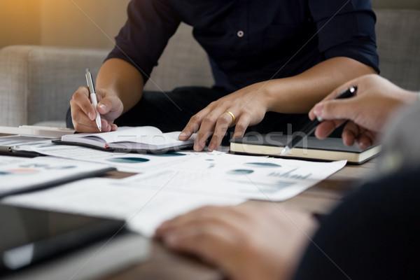 Csoport sikeres üzletemberek megbeszél papírmunka laptopot használ Stock fotó © snowing
