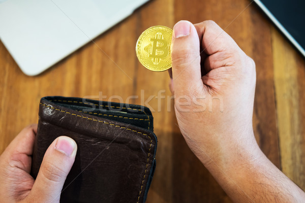 hand with golden metal Bitcoin crypto currency investment- symbo Stock photo © snowing