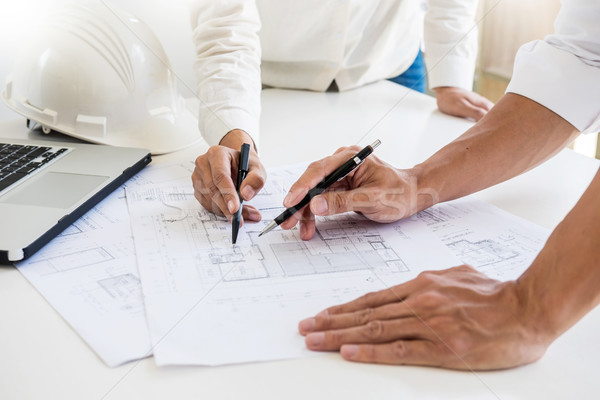 Close-up Of Person's engineer Hand Drawing Plan On Blue Print wi Stock photo © snowing