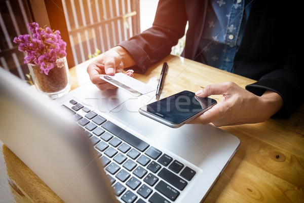 Cropped image of woman inputting card information and key on pho Stock photo © snowing