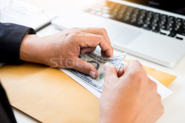 business man counting money at the table, accounting concept Stock photo © snowing