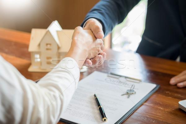 House developers agent or financial advisor and customers shakin Stock photo © snowing