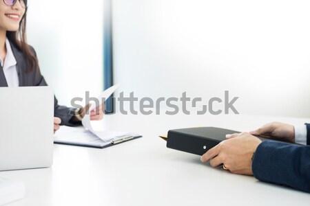 Femenino gerente solicitante mirando cv Foto stock © snowing