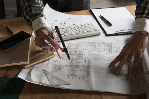 Creative architect projecting on the big drawings in the dark lo Stock photo © snowing