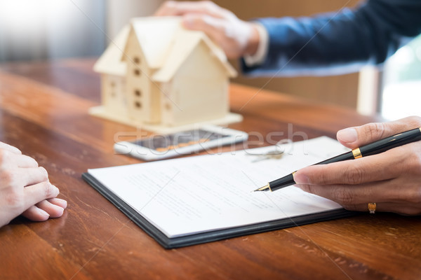 Real Estate concept, Agent to present the propertyprice for l Stock photo © snowing