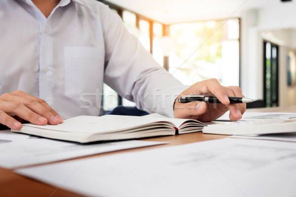 Accountant or banker calculating balance. finances investment ec Stock photo © snowing