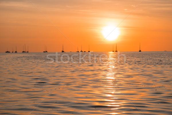 Gyönyörű naplemente fölött tenger tengerpart tájkép Stock fotó © snowing