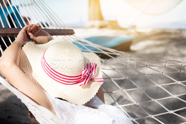 relax and happy woman on cradle at beach and green sea Stock photo © snowing