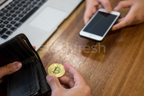 hand exchange golden metal Bitcoin crypto currency investment- s Stock photo © snowing