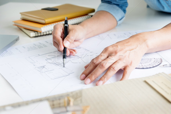 Person's engineer Hand Drawing Plan On Blue Print or working pro Stock photo © snowing