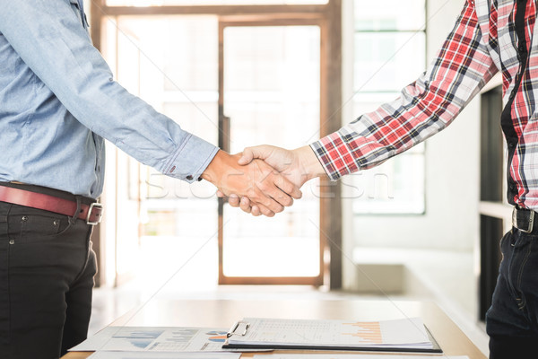 Two confident business man shaking hands during a meeting in the Stock photo © snowing