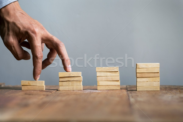 Hand liken business person jump a toy staircase to success, busi Stock photo © snowing