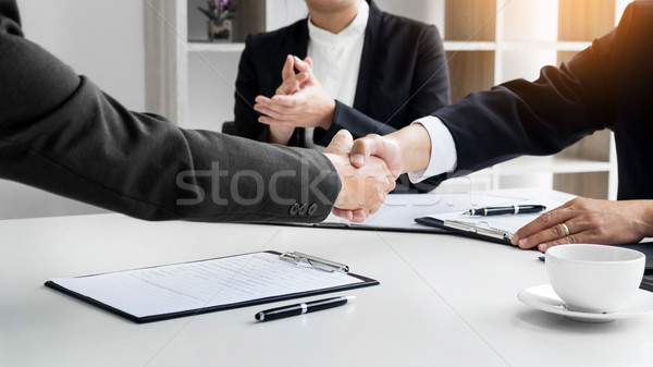 successful business team shaking hands with eachother in the off Stock photo © snowing