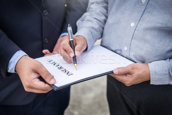 Car insurance agent send a pen to his customers sign the insuran Stock photo © snowing