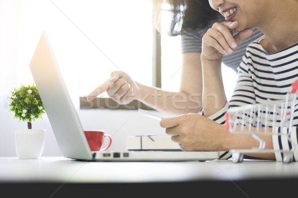 Two excited roommates friends shopping online with credit card a Stock photo © snowing
