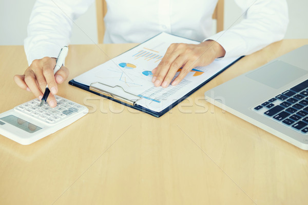 Close up of female accountant or banker making calculations. Sav Stock photo © snowing