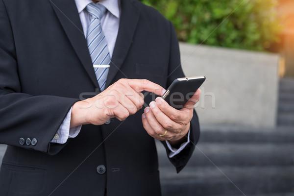 Iş adamı siyah takım elbise modern açık Stok fotoğraf © snowing