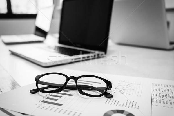 A note book, laptop, glasses, mouse, vintage compass, coffee cup Stock photo © snowing