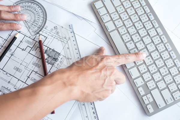 Top view of architect drawing on architectural project,Projectin Stock photo © snowing