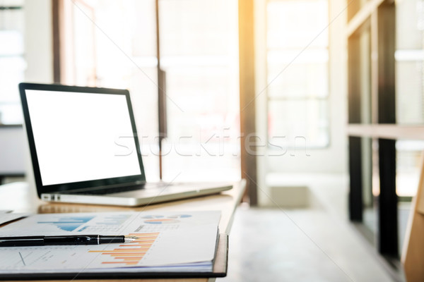 Sideview of office desktop with blank laptop and various office  Stock photo © snowing