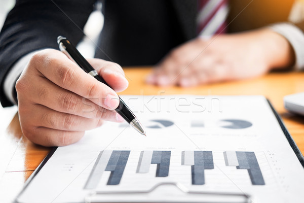 Business man analysed report of profit finance data graph docume Stock photo © snowing