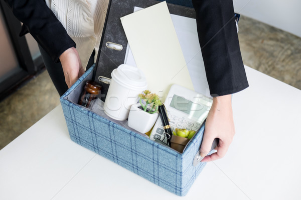business woman packing personal company belongings when she deci Stock photo © snowing