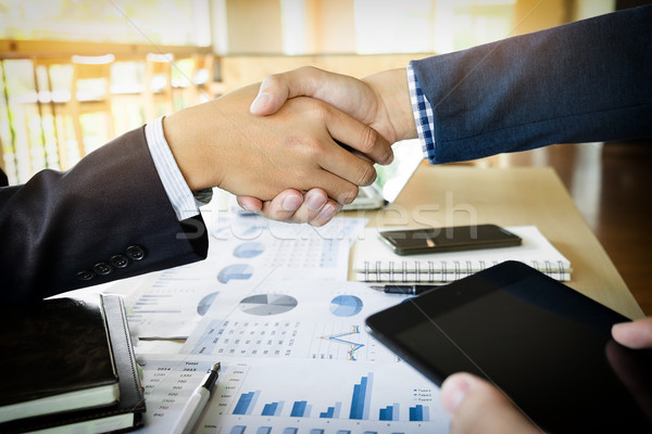 Businessmen shaking hands during a meeting Stock photo © snowing