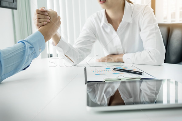 two clasped hands of businessmen Stock photo © snowing