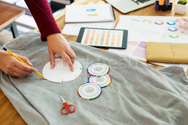 Stock photo: Female fashion designer working with sketches at studio and choo
