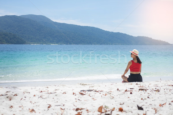 Young woman Yoga meditation on beach. relaxing sitting in water  Stock photo © snowing