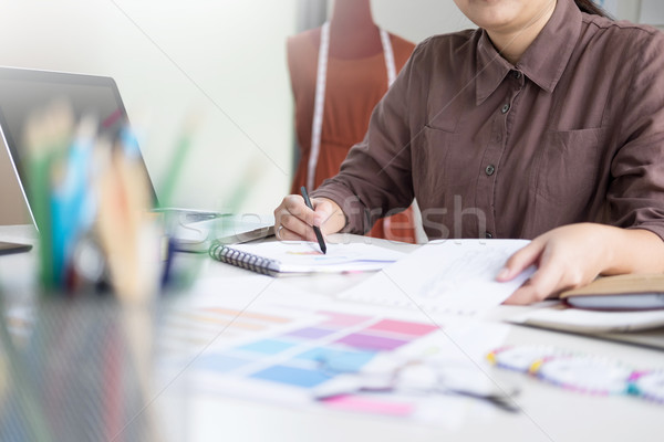 female designer choosing colour on pantone for her fashion desig Stock photo © snowing