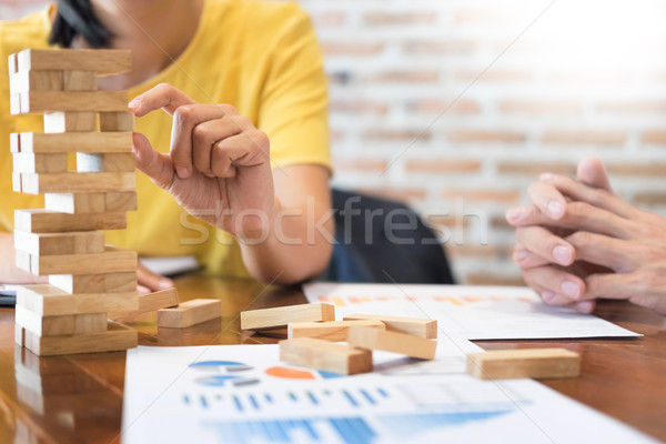 Group of business creative people building tower by wooden block Stock photo © snowing