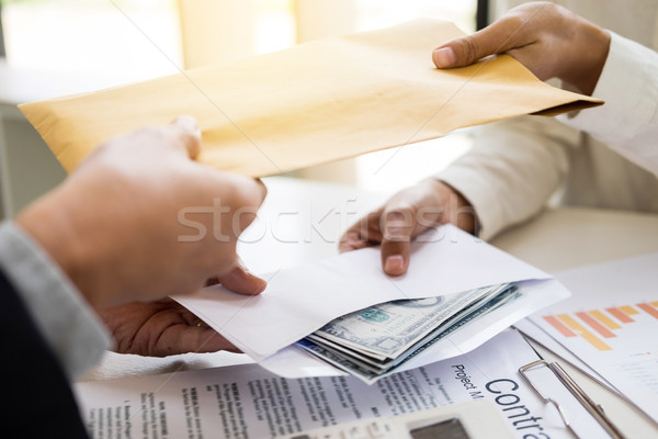 Corrupted businessman, or politician bribe in the form of hundre Stock photo © snowing
