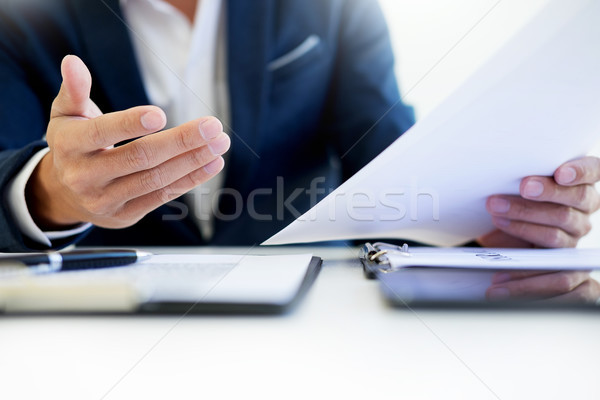 Man signing a car insurance policy, the agent is holding the doc Stock photo © snowing
