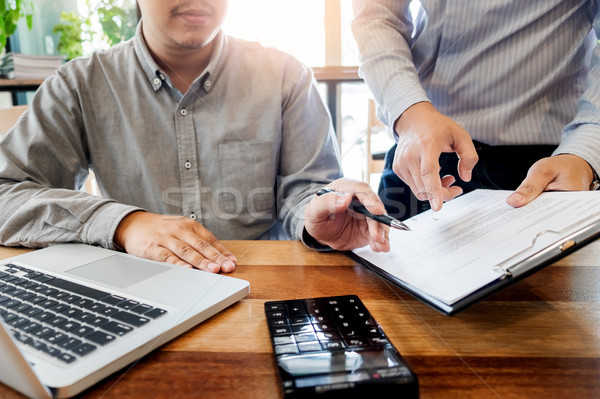Team work process. young business managers working with startup  Stock photo © snowing