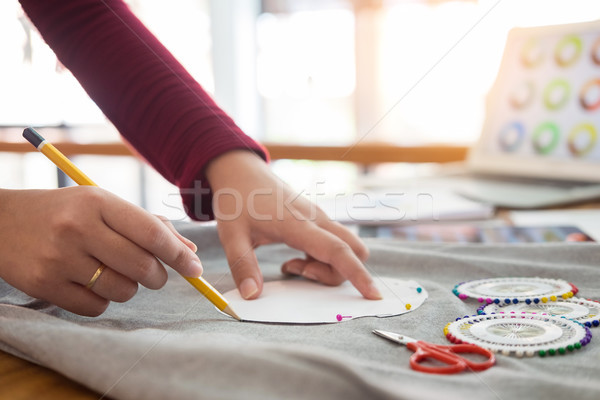 Female fashion designer working with sketches at studio and choo Stock photo © snowing