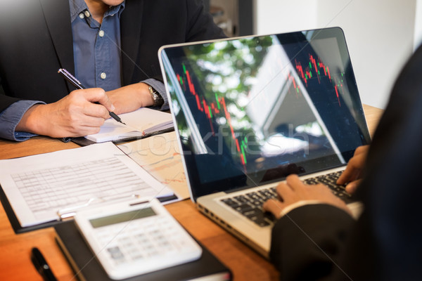 Finance trade manager showing reports screen analysis finance cu Stock photo © snowing