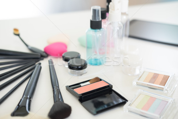 Cosmetic set on light dressing table. Stock photo © snowing