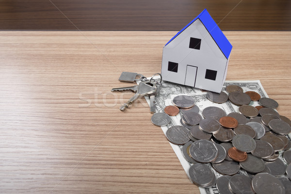 holding house representing home ownership and the Real Estate bu Stock photo © snowing