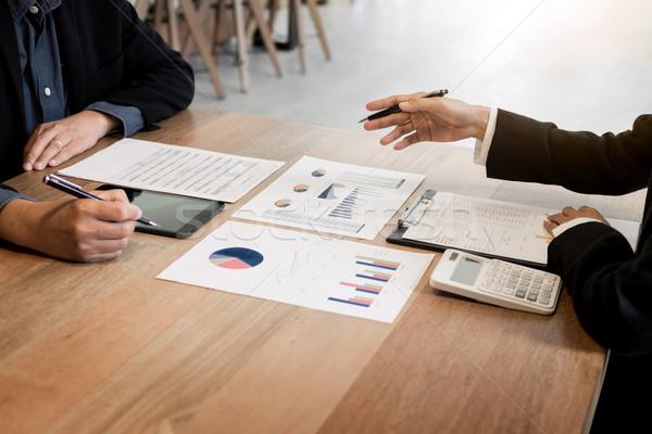 Grupo bem sucedido pessoas de negócios discutir papelada usando laptop Foto stock © snowing