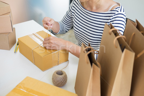 Business owner woman working online shopping prepare product pac Stock photo © snowing