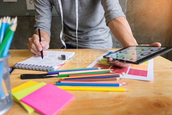 men working as fashion designer choosing on colour chart for clo Stock photo © snowing