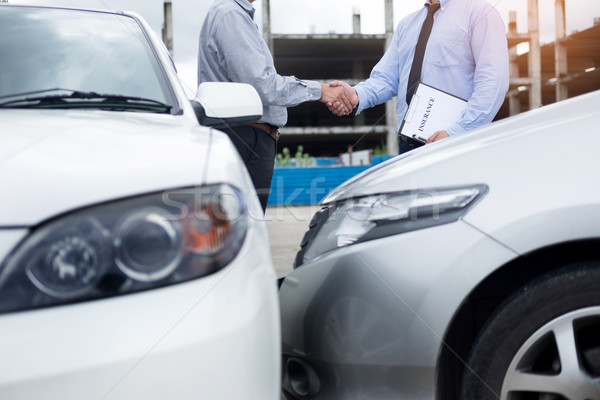 Customer shake hand with auto insurance agents after agreeing to Stock photo © snowing