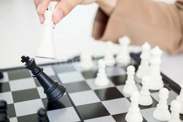 Business Strategic Formation in the chess game king is checkmate Stock photo © snowing