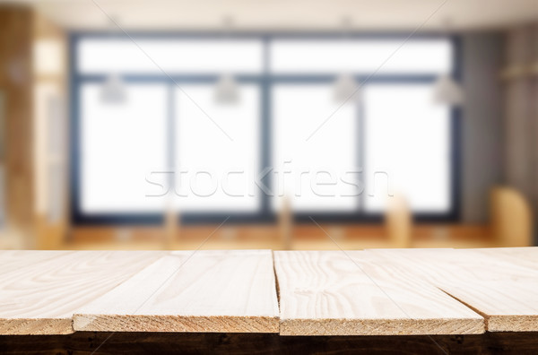 Empty of wood table top on blur of window glass in the morning b Stock photo © snowing
