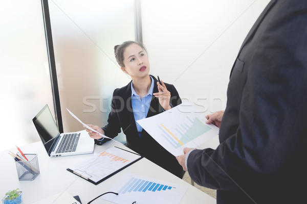 Active woman Manager explaining colleagues latest profit financi Stock photo © snowing