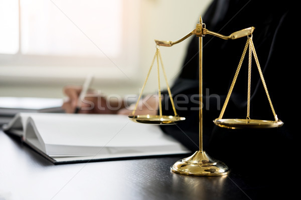 lawyer judge reading documents at desk in courtroom Stock photo © snowing