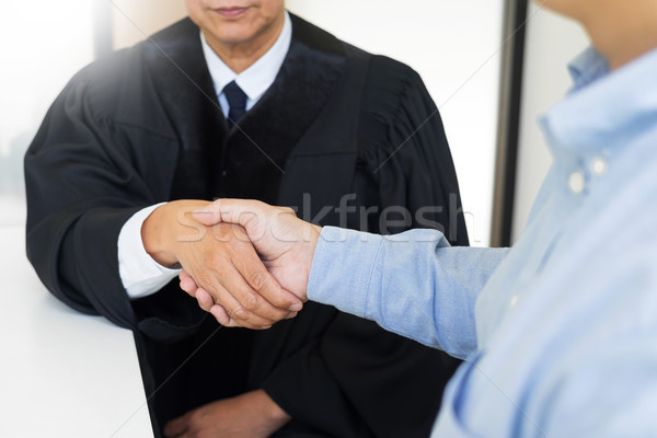 Gavel hammer Justice on wooden table with judge and client shaki Stock photo © snowing