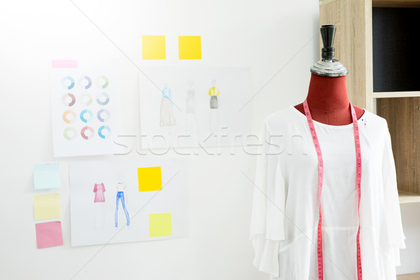 garment design on mannequin Red dummy with measuring tape in tai Stock photo © snowing
