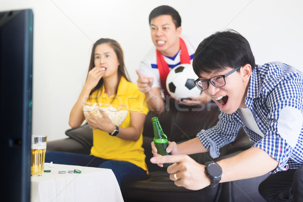 friendship, sports and entertainment concept - happy male friend Stock photo © snowing